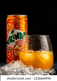 MINSK, BELARUS-OCTOBER 31, 2018: Glass and Can of Mirinda orange. Mirinda is a brand of soft drink originally created in Spain in 1959, with global distribution.