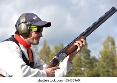 MINSK, BELARUS-SEPTEMBER 25: Unidentified sportsman concentrates before shooting at the open of the 2011 Belarussian Championship  Sporting on September 25, 2011 in Minsk, Belarus.