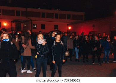 MINSK, BELARUS.September 30,2017. A group of people watching a street concert