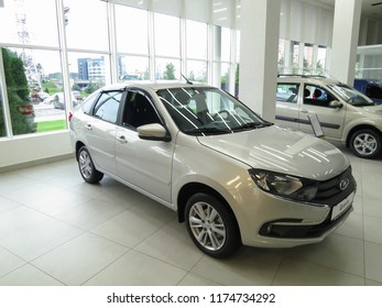 Minsk, Belarus-September 5, 2018: A new model of the Russian car Lada Grant. Silver car in the showroom Lada Granta.