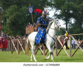 Minsk, Belarus-September 8, 2018:  Knight riding a horse close-up. Medieval battle.
