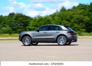 MINSK - JUNE 2014: Porshe Macan S drives along the road during the test drive event for automotive journalists from Minsk