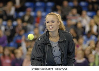 MINSK - NOVEMBER 19: Denmark's tennis star Caroline Wozniacki plays during their charitable tennis match  in Minsk, Belarus, on November 19, 2010