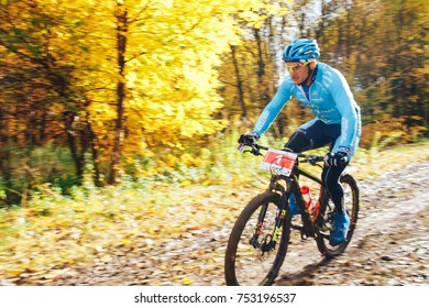 Minsk October 15, 2017 Bike ride A man is riding a bicycle in the park