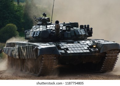 """Minsk Region, Belarus - SEPTEMBER 8, 2018: Modern combat vehicles ride perfomance on the holiday """"Tankman Day - 2018"""", which occurred on the IKK """"Stalin-Line"""".  Belarusian team of tank biathlon, T-72."""