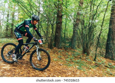 Minsk region Kryzhovka October 8, 2017 Bike ride A man riding a bicycle in the forest