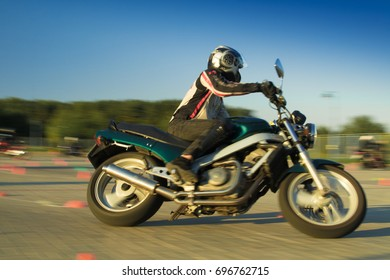 MINSK, REPUBLIC OF BELARUS - AUGUST 08, 2017: MotoGymkhana-Minsk motorcycle driving competition. Photo with texture high speed effect with blur background for design.
