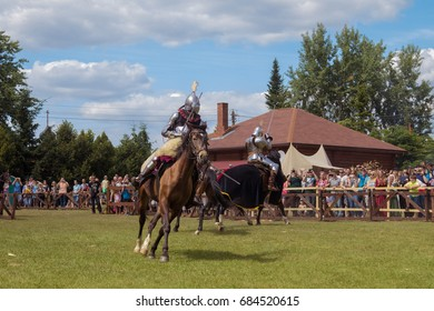 """MINSK, REPUBLIC OF BELARUS - July 23, 2017: Museum complex of ancient folk crafts Dudutki. The festival """"Our Grunwald 2017"""". Equestrian tournament according to the rules of the XIV century."""