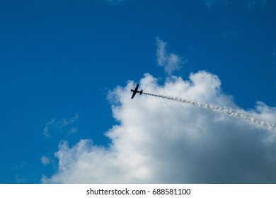 """MINSK, REPUBLIC OF BELARUS - July 30, 2017: Festival of Aviation Sports """"About the Sky"""". Simulation of the air battle of two aircraft."""