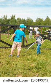 """MINSK, REPUBLIC OF BELARUS - JUNE 02, 2018: IV Festival of historical reconstruction """"The Age of Chivalry"""". Children participate in a knight battle with toy armor."""
