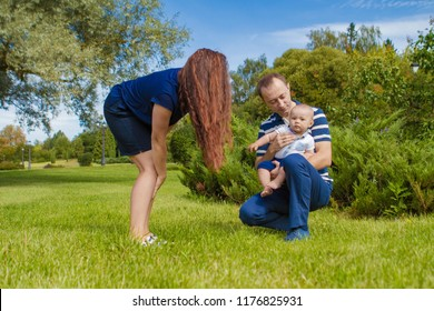 MINSK, REPUBLIC OF BELARUS - SEPTEMBER 13, 2018: A family with a small child is photographed in a clearing in the park.
