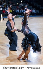 Minsk,Belarus- December 17,2017: Professional Dance Couple Performs Youth Latin-American Program on WDSF International Championship Alliance Trophy in December 17, 2017 in Minsk, Belarus