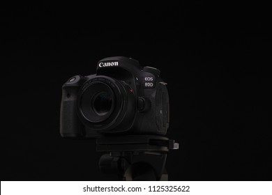 Minsk,Belarus - March 15, 2018:black camera canon 80D on black background