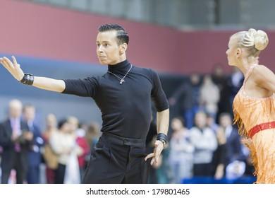 MINSK-BELARUS,FEBRUARY,9:Egor Kosyakov-Anastasiya Belmach Perform Adult Latin-American Program on Ogni Stolicy(Lights of the Capital) WDSF  Championship on February,9,2014,in Minsk,Republic of Belarus
