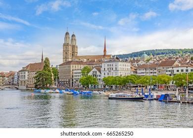 Minster Grossmunster in Zurich, view from Quaibrucke bridge, river Limmat in front.