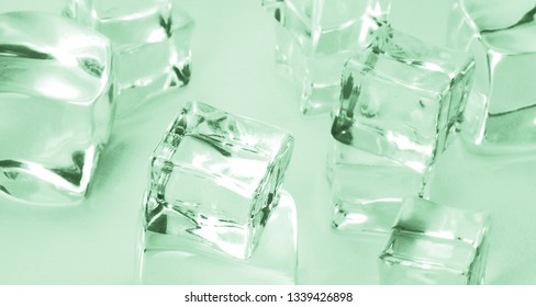 Mint background. Ice close up on green background. Mint color of the year 2020.