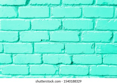 Mint brick wall texture. Background with copy space for design. Trendy green and turquoise color.