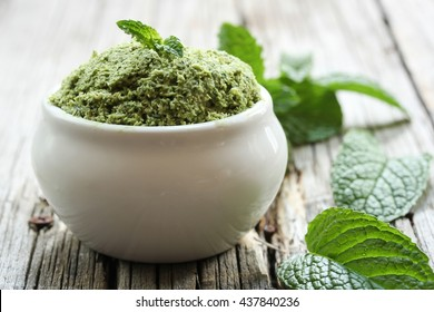 Mint Chutney with fresh mint leaves coconut and yogurt / Mint coconut chutney, selective focus