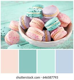 Mint color matching and sweet macarons, closeup