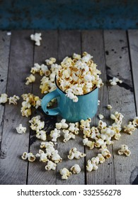 Mint cup full of popcorn