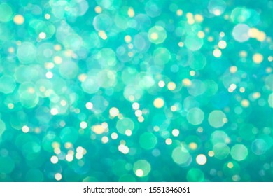 Mint festive background with sparkles in the bokeh. The concept of the celebration, the day of St. Valentine, New Year, birthdays, ceremonies, events, etc.