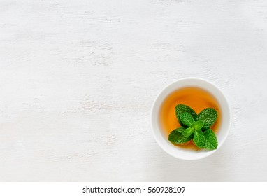 Mint flavored tea background, view from above, space for a text
