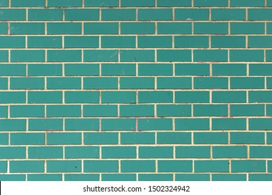 Mint green dirty brick wall background texture