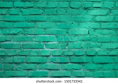 Mint green painted brick wall texture for background.