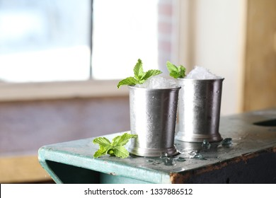 mint julep drink in silver cups with mint