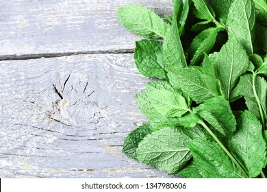 Mint leafs on grey wooden table