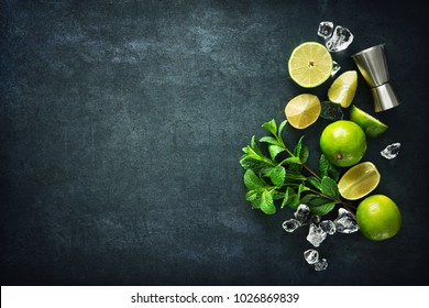 Mint, lime, ice, ingredients and bar utensils for making mojito cocktail