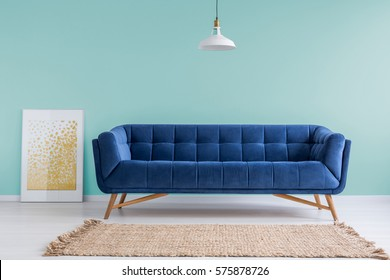 Mint Living Room With Blue Sofa Rug And Lamp