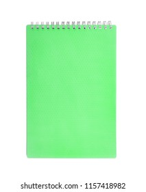 Mint notepad with spring isolated on white background.