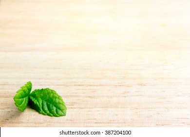 Mint on wooden background