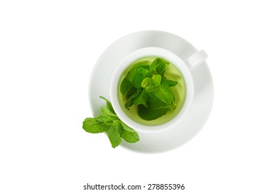 Mint tea with fresh mint in a white cup, top view, closeup, isolated on white