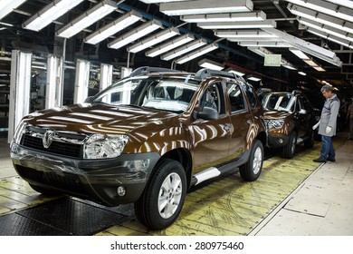 Mioveni, Romania - October 13, 2014: Color picture of a worker on the assembly line of the Duster model at the Dacia Renault factory.