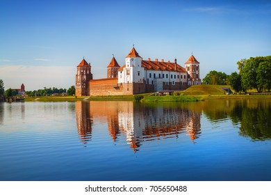 Mir, Belarus - August 11, 2016: Ancient medieval fortress on the shore of the lake. Castle in Mir, Belarus - historical heritage of Belarus. UNESCO World Heritage. Traveling on Belarus