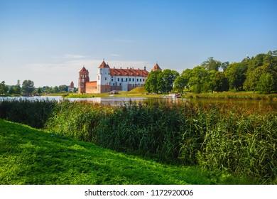 Mir, Belarus - August 11, 2017: Castle on the shore of the lake. Castle in Mir, Belarus - historical heritage of Belarus.