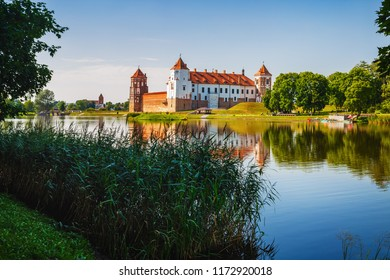 Mir, Belarus - August 11, 2017: Ancient medieval castle on the shore of the lake. Castle in Mir, Belarus - historical heritage of Belarus. UNESCO World Heritage.