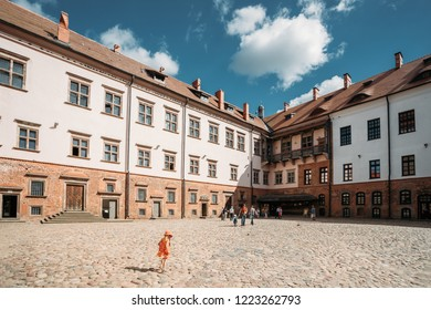 Mir, Belarus - August 30, 2016: People Visit Courtyard Of Mir Castle. Architectural Ensemble Of Feudalism, Ancient Cultural Monument, UNESCO Heritage. Famous Landmark
