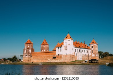 Mir, Belarus. Mir Castle Complex. Architectural Ensemble Of Feudalism, Ancient Cultural Monument, Famous Landmark In Summer Sunny Day Under Blue Sky, Copyspace.