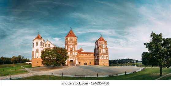 Mir, Belarus. Mir Castle Complex On Blue Sunny Sunset Sky Background. Architectural Ensemble Of Feudalism, Cultural Monument, UNESCO Heritage. Famous Landmark In Summer. Panorama, Panoramic View