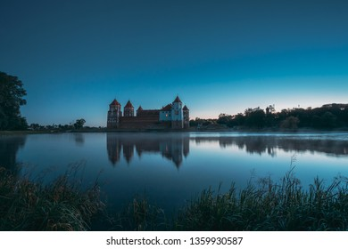 Mir, Belarus. Mir Castle And Lake During Early Summer Morning Time. Cultural Monument, UNESCO World Heritage Site. Famous Landmark And Popular Destination.