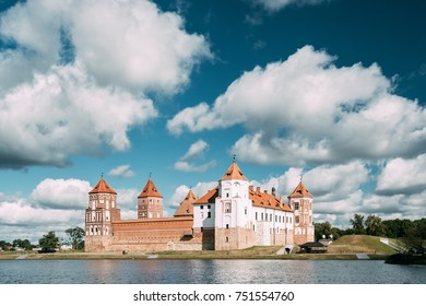 Mir, Belarus. Mir Castle And Lake In Summer Sunny Day. Cultural Monument, UNESCO Heritage.