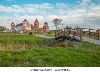 Mir, Belarus. Scenic View Of Castle Complex Mir On Sunny Sunset Sky Background. Old Towers Are. History of Belarus