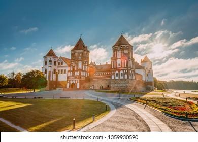 Mir, Belarus. Sunshine Above Castle Complex Mir During Summer Morning Sunrise. Cultural Monument, UNESCO World Heritage Site. Famous Landmark And Popular Destination.
