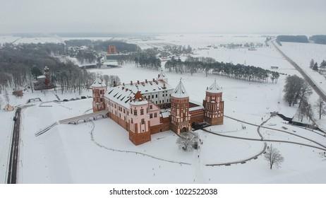 Mir Castle, Belarus in fog. Flying above