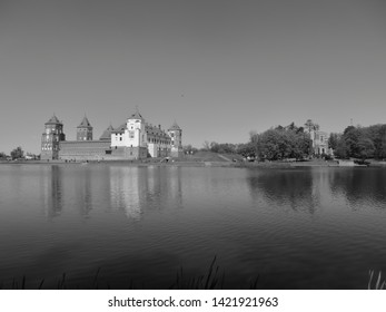 The Mir Castle Complex. Mir. Belarus. Black and white photo of the castle and Church landscape