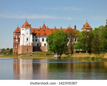 The Mir Castle Complex. Mir. Belarus. The landscape of the fortress of a medieval castle with red roofs