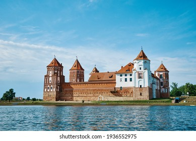 Mir castle complex in a summer day with blue cloudy sky. Tourism landmark in Belarus, cultural monument, old fortress - Shutterstock ID 1936552975